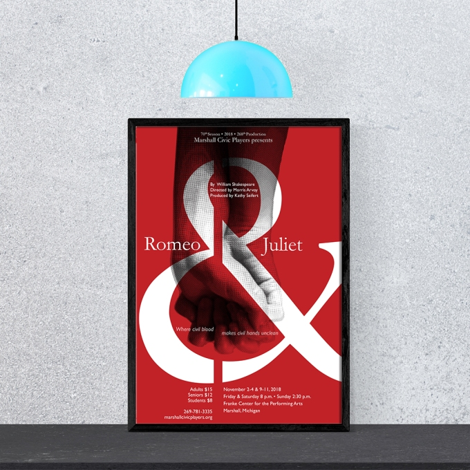 Romeo and Juliet poster in red, showing two hands grasped together overlaid with an ampersand. Poster sits on frame with concrete wall background.